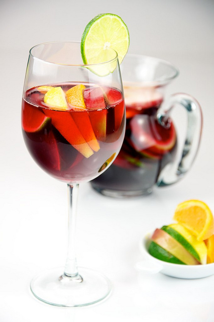 Red Wine Sangria with lemon, lime, apple, and orange served in a glass.